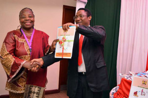 WHO Representative in Kenya Custodia Mandlhate (left) and Department of Preventive and Promotive Health head Jackson Kioko at the launch of the Nutrition and HIV Survey report at the Sarova Panafric Hotel in Nairobi on October 27, 2015. PHOTO | ROBERT NGUGI | NATION MEDIA GROUP