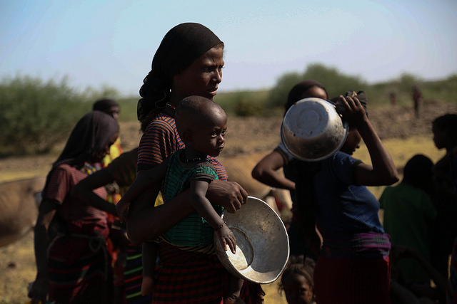 A mother with her child is waiting her turn to get drinking water at Keroma Kebele where a water truck is distributing to the people in Gewane woreda (district), Afar region, Ethiopia. © UNICEFE Ethiopia